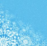 Christmas blue background. Abstraction snow background with snowflakes Stock Photos