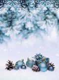 Christmas blue background with balls hanging on pine tree. Stock Image