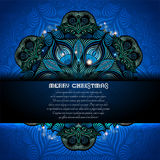 Christmas blue background with big snowflake from plant and flower pattern. In the center Stock Images