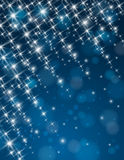 Christmas blue background with brilliance stars Royalty Free Stock Images