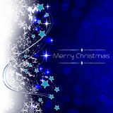 Christmas blue background with decoration. Christmas greeting card with snowflakes, stars, shiny effect and bubbles on a background Royalty Free Stock Photos