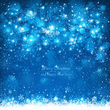 Christmas blue background. Blue background with falling snowflakes Stock Photography