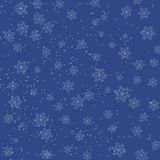Christmas blue background with falling snowflakes Stock Photos