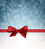 Christmas blue background with gift bow. Stock Photography