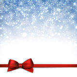 Christmas blue background with gift bow. Royalty Free Stock Photos