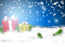 Christmas blue background with gift boxes. Royalty Free Stock Image