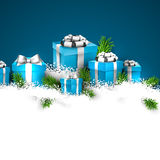 Christmas blue background with gift boxes. Abstract christmas background with fir branches and realistic gift boxes. Vector illustration Stock Photo
