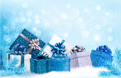 Christmas blue background with gift boxes and snow Stock Images