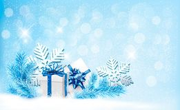 Christmas blue background with gift boxes and snow Royalty Free Stock Photo