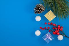 Christmas blue background. Gift or present box and holiday decoration top view. pine cones and decorative snowballs, Happy New Yea