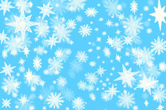 Christmas blue background with a lots of snow flakes and stars w Stock Images
