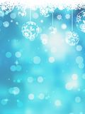 Christmas blue background with snow flakes. Royalty Free Stock Photo