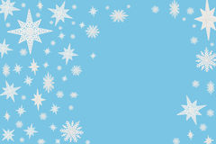Christmas blue background with snow flakes and stars. Stock Image