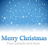 Christmas blue background with snow flakes Royalty Free Stock Image