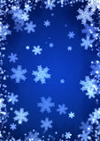 Christmas blue background with snowflakes. Christmas background of blue color with snowflakes Stock Images