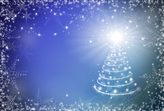 Christmas blue background with snowflakes frame and Christmas tr. Ee Royalty Free Stock Image