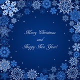 Christmas blue background with snowflakes frame and text Stock Photos