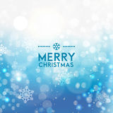 Christmas blue background with snowflakes. Glitter snowflakes and snow Stock Images