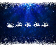 Christmas blue background with snowflakes and Santa. Abstract blue background with frame from snowflakes and flying Santa, illustration Royalty Free Stock Photo