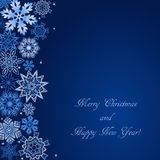 Christmas blue background with snowflakes at the side and with text. Vector winter pattern for Christmas and New Year holidays Stock Images