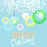 Christmas blue background with transparent colorful balls and elegant gold and white lettering. EPS10. Christmas background with transparent colorful balls and Stock Images