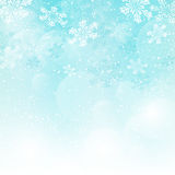 Christmas blue background. Christmas background with white snowflakes Stock Photos