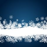 Christmas blue background with white snowflakes. Border Royalty Free Stock Photo
