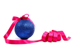 Christmas blue ball with holiday pink ribbon. Royalty Free Stock Photography