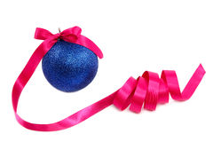 Christmas blue ball with holiday pink ribbon. Stock Photography