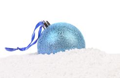 Christmas blue ball on a snow. White background Stock Images