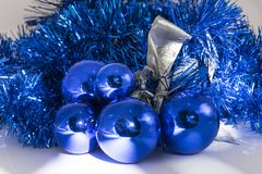 Christmas in blue. Blue balls with silver bow used as Christmas decoration stock image