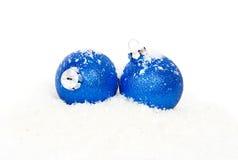 Christmas blue balls on snow Royalty Free Stock Image