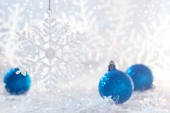 Christmas blue balls on white background with snowflakes. Selective focus.  Stock Photo