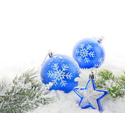 Christmas blue bauble and snow Stock Photo