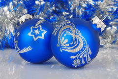 Christmas blue baubles against shiny background Stock Photos