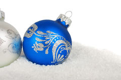 Christmas blue baubles on snow Royalty Free Stock Photos