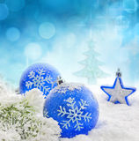 Christmas  blue baubles on snow background Royalty Free Stock Image