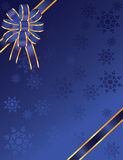 Christmas blue bow with snowflakes Stock Images