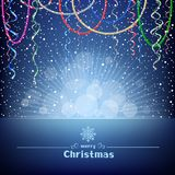 Christmas blue card with beads ribbons and light Royalty Free Stock Photography
