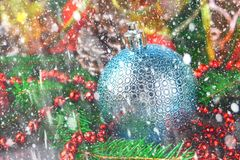 Christmas blue decorative balloon surrounded by fir branches. stock photos