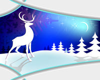 Christmas blue design with frame. Christmas blue background framed with pine trees,a moon with stars and a reindeer standing in the snow Royalty Free Stock Photography