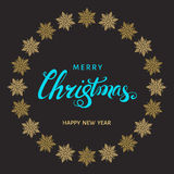 Christmas  blue  lettering with gold  snowflakes on black  back Stock Photos