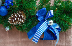 Christmas blue ribbon on green New Year tree branch Stock Photography