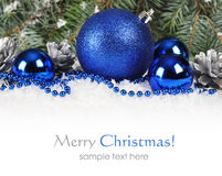 Christmas in blue and silver. Christmas border with  blue and silver Christmas decorations and snow Royalty Free Stock Images