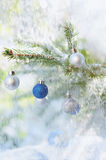 Christmas blue and silver balls on christmas tree in snowfalls Royalty Free Stock Images