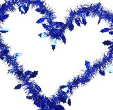 Christmas blue tinsel in form of heart. Stock Photos