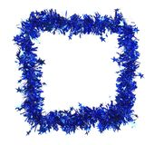Christmas blue tinsel with stars as frame. Royalty Free Stock Image