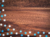 Christmas, blue and white paper snowflakes on wood Royalty Free Stock Photography
