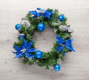 Christmas blue wreath on wood Royalty Free Stock Images