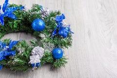 Christmas blue wreath on wood Royalty Free Stock Image